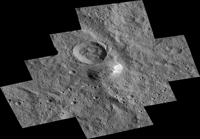 The mysterious mountain Ahuna Mons is seen in this mosaic of images from NASA's Dawn spacecraft. Dawn took these images from its lowest-altitude orbit. Photo Credit; NASA